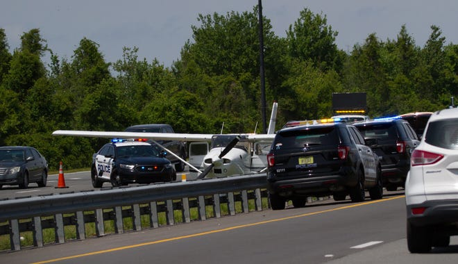 A Cessna 182 Skylane plane sits in the median of the Polk Parkway after the pilot made an emergency landing Thursday less than a mile east of the Airport Road exit. No one was injured, the Lakeland Police Department reported.