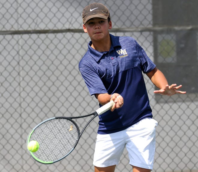 Winter Haven's Colin Lopez hits  a forehand during a doubles match at the Class 4A, District 6 boys tennis tournament at the Winter Haven City Courts. He adanced to the finals at No. 1 singles.