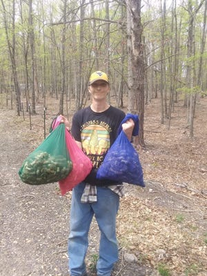 Boone Minshall of Keyser proudly displays some of his finds on a typical day of mushroom hunting.