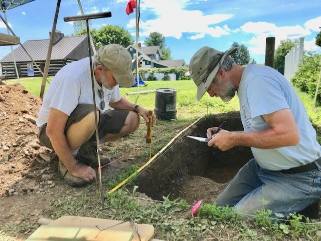 Volunteers Roy Brown and Brent Chippendale examine an artifact found at a previous dig at Ashby's Fort.