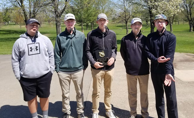 Senior Caleb Nagel holds the  2021 Marceline Boys Golf Invitational team championship trophy won April 14 by Westran High School. Nagel's varsity teammates are sophomore Aiden Brockleman (left), junior Colin Brandow, and juniors Logan Bain and Aidan Seiders (right). Not shown is Hornets golf coach Jeff Schleicher.