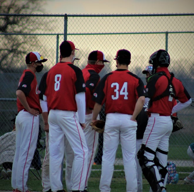 New Boston Huron coach Phil Yancey makes a trip to the mound to talk to his team during the seventh inning against St. Mary Catholic Central on Wednesday, April 14, 2021.