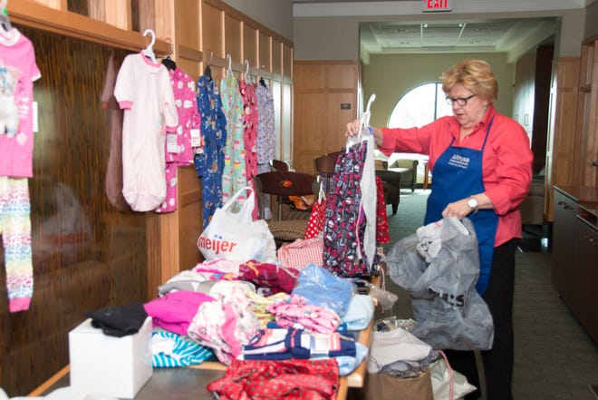 Darlene Luft sorts donations during the 2019 Altrusa International of Monroe's PJ Party.