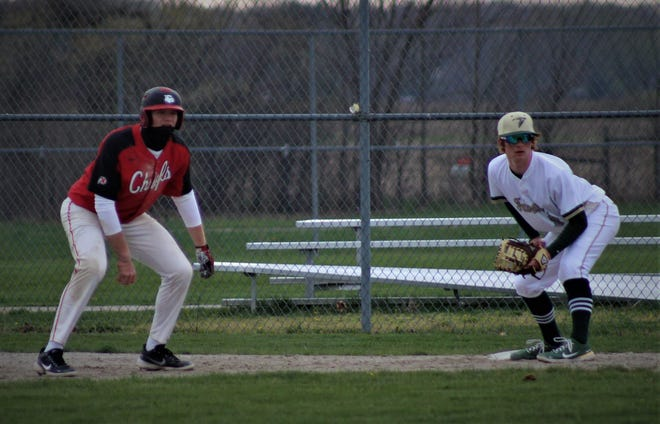 SMCC's Nolan Moore (right) waits for a pickoff attempt at first base as New Boston Huron's Ethan Webb leads off the base  in a game earlier this season. Webb homered in each game as Huron won the Division 2 District at Summit Academy Saturday.