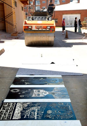 A steamroller prepares to roll over large-scale blocks carved from wood to print on Tyvek. Artspace at Untitled is a nonprofit art gallery and print studio located in the Deep Deuce District, just east of Broadway.