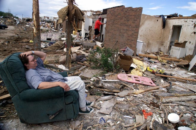 Vanessa Nelson, 44, sits in her recliner staring at what was once her first floor apartment at the Emerald Springs Apartment complex in southwest Oklahoma City, Okla., on Wednesday, May 5, 1999. (AP Photo/Beth A. Keiser)