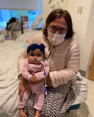 Dr. Leslie Lehmann, a bone marrow transplant expert at Boston Children's Hospital, holds baby Lawson.