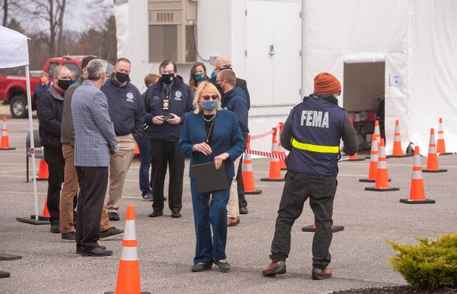 Gov. Janet Mills arrives at a news conference on Monday, April 12, 2021, at Maine's first mobile COVID-19 vaccination clinic in Oxford, Maine. The clinic is set up in the parking lot of the Oxford Casino and will travel to other rural areas throughout the state.