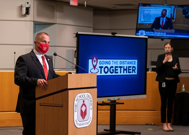 Palm Beach County Schools Deputy Superintendent Keith Oswald speaks and Jamie B. Aranda interprets during a press conference at district headquarters in West Palm Beach, Florida on April 15, 2021. GREG LOVETT/PALM BEACH POST