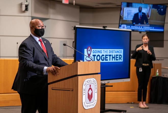 Palm Beach County Schools Superintendent Donald Fennoy speaks and Jamie B. Aranda interprets his words during a press conference at district headquarters in West Palm Beach, Florida on April 15, 2021. GREG LOVETT/PALM BEACH POST