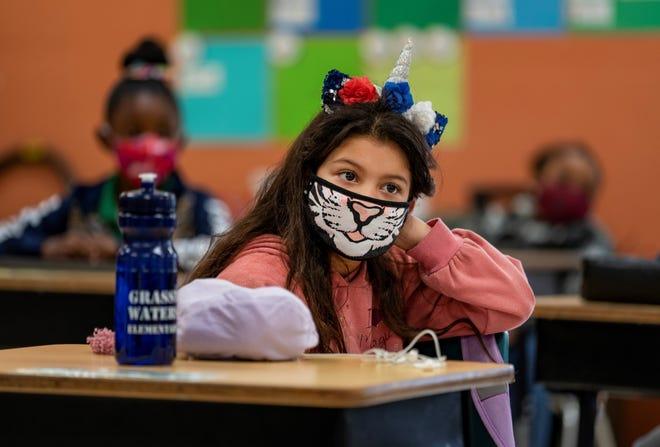 Third grader Alexa Posada, 8, listens to her teacher at Grassy Waters Elementary School in West Palm Beach, Florida on January 8, 2021.  GREG LOVETT/PALM BEACH POST