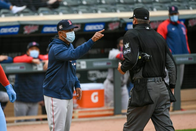 Red Sox manager Alex Cora, left, who has led his team to a 9-4 record despite losing the first three games of the season, is ejected by umpire Jordan Baker as he argues a call that favored the Twins Thursday in Minneapolis.