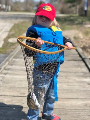Benjamin Desmond, 3, with his first trout caught on opening day last week. He was fishing with his grandfather, Greg Vespe of Tiverton.