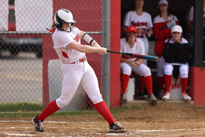 Field's Olivia DeVries delivers a first-inning homer against Springfield in Metro Athletic Conference action.