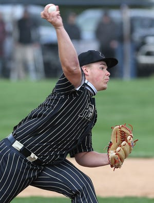 Perry's Anthony Brumbugh delivers a pitch during Wednesday's game at Hoover.