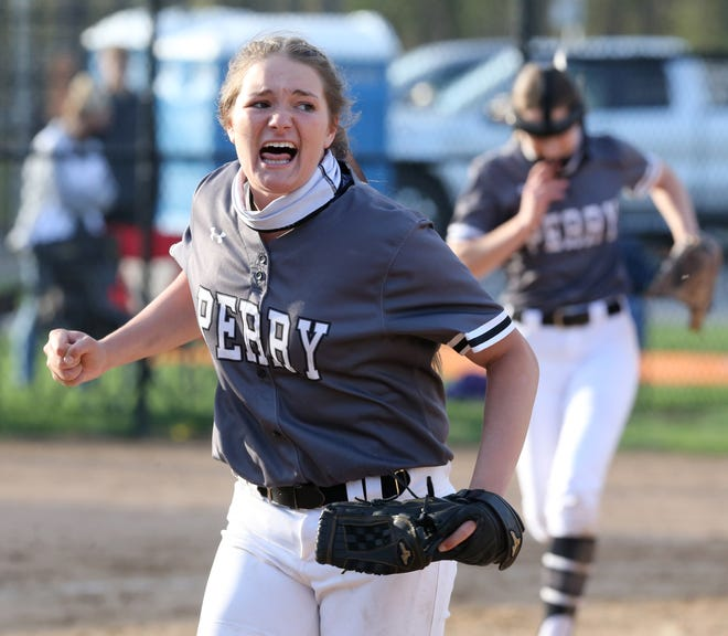 Melissa Holzopfel of Perry reacts after the final out of their 7-4 victory over Hoover at Hoover on Wednesday, April 14, 2021.