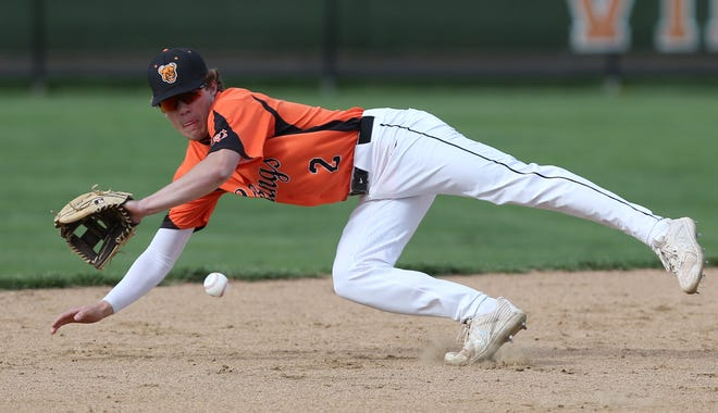 Connor Ashby of Hoover fields a ball hit by Maguire Dearing of Perry but isn't able to recover in time to get the batter out at first base during their game at Hoover on Wednesday, April 14, 2021.