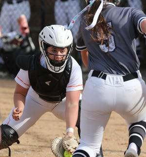 Faith Kiko (left) of Hoover prepares to tag out Kailee Wilson of Perry at the plate during their game at Hoover on Wednesday, April 14, 2021.