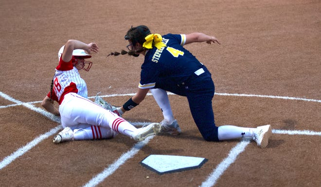 Stephenville pitcher Jaylee Matthews tags out Glen Rose's Felicity Austin at the plate during District 6-4A softball action Tuesday night in Glen Rose. The Honeybees managed just three hits in the 11-1 loss to the Lady Tigers, who wrapped up the district title with the win.