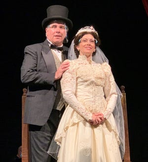 "Chris Caswell, left, and Sarah Cassidy star in the Manatee Players production of ""I Do! I Do!"""