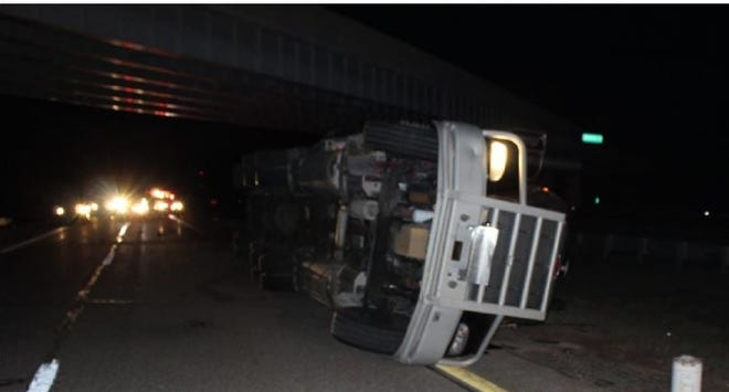 The semi truck laying sideways on I-75 at the Mackinac Trail overpass.