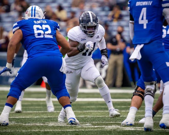 Georgia Southern linebacker Todd Bradley-Glenn (11) charges toward Georgia State quarterback Cornelious Brown IV (4) at Center Parc Stadium on Nov. 28, 2020 in Atlanta.