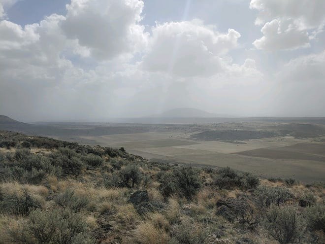 Dust clouds form over a water refuge in Southern Oregon normally filled with wildlife.