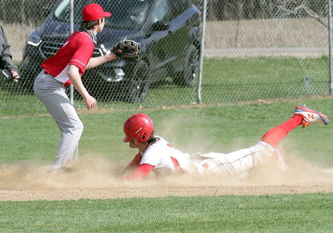 Josh West of Colon slides safely into third base against Camden Frontier on Wednesday.