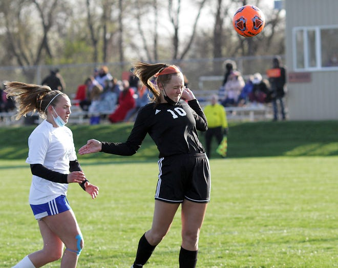 Ally Yesh of Sturgis heads a ball in for a goal off an assist from Allison Landess in prep soccer action on Wednesday.