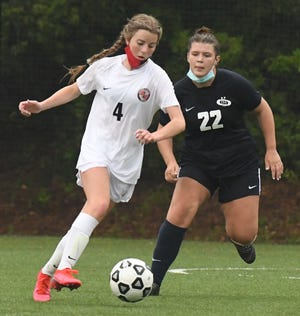 Coastal Christian's Bryna Barton looks for an opening during the Centurions' soccer match against Cape Fear Academy earlier this month.