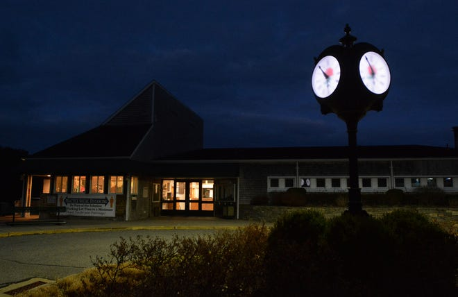 The sky is still dark just before 6 a.m. as maintenance employees start to arrive at the Norwich Golf Course.