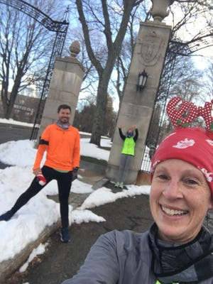 From left, Andrew MacDonald, Jess Howland and Jen Graves enjoy a light moment at Holy Cross during their quest of running every street in Worcester.