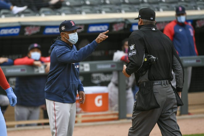 Red Sox manager Alex Cora, left, is ejected by umpire Jordan Baker as he argues balls and strikes during the eighth inning of Thursday's game in Minneapolis.
