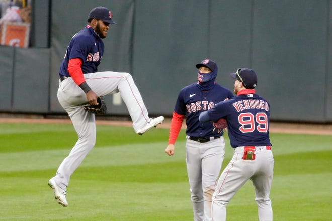 Boston center fielder Franchy Cordero (16) jumps to celebrate with teammates right fielder Enrique Hernandez (5) and center fielder Alex Verdugo (99) after defeating the Minnesota Twins in the second baseball game of a doubleheader on Wednesday.