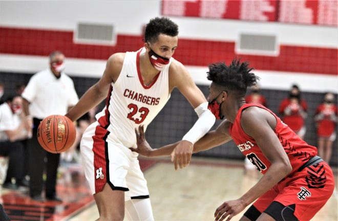 Wauwatosa East's Leon Bond (30) defends Sussex Hamilton's Patrick Baldwin Jr. during Tosa East's 90-84 victory over the Chargers on Tuesday, Dec. 1, 2020, at Hamilton High School. Baldwin scored a game-high 43 points.  Tosa East Sussex Hamilton 7 Dec 1 20201