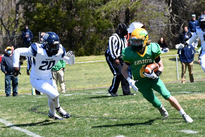 Eastern Alamance's Kasen McCawley, right, carries the ball as Western Alamance's Calvin Galloway Jr. pursues.