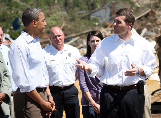 Tuscaloosa Mayor Walt Maddox, right, speaks with President Obama as they tour damaged areas in the Alberta area of Tuscaloosa, Ala. Friday, April 29, 2011. [Staff file photo]