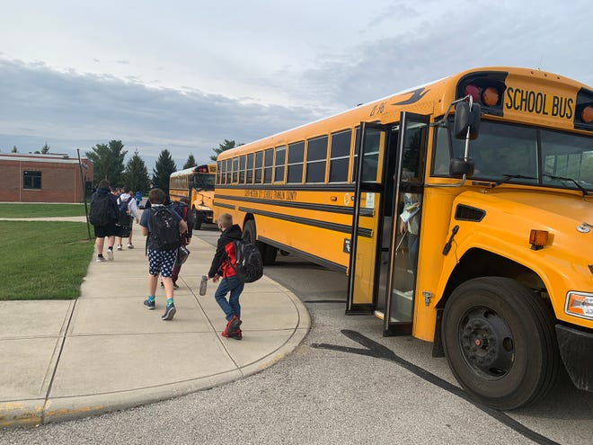 A school bus arrives to drop off students at the South-Western City School District's Hayes Middle School, where all-in classes resumed April 5.