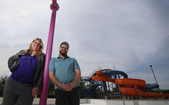 Kelly Sutherland, Grove City's recreation superintendent, and Jacob Hooker, general manager for the Columbus division of SwimSafe Pool Management, stand near the Big Splash Family Aquatics Center, 2831 Southwest Blvd. SwimSafe Pool Management will manage Big Splash, which is expected to open May 29.