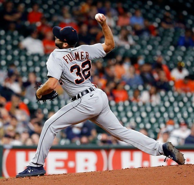 Michael Fulmer # 32 dari Detroit Tigers melempar pada inning pertama melawan Houston Astros di Minute Maid Park pada 14 April 2021 di Houston, Texas.