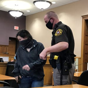 Cheyanne Wierichs is escorted by a Kewaunee County sheriff's deputy from Kewaunee County Circuit Court following an April 15 hearing.