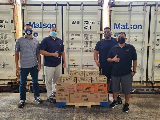"""Marianas Pacific Distributors, of Saipan, recently donated beverages to the Ohala Foundation, which will be part of weekly family food boxes. """"Companies like Marpac help us continue our goals and we want to thank their owners, their resident manager Guy Pudney, and the employees of this fine company for their generosity,"""" said Ohala board member Ed Arriola, Jr. Pictured, from left, are: Beverage sales manager James Lee; resident manager Guy Pudney; Ohala board membernArriola; and consumer manager Tom Basa Jr."""