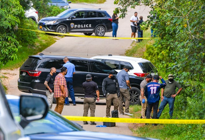 Officers with the Guam Police Department conduct a death investigation after a lifeless man was discovered along Swamp Road in Dededo on Thursday, April 15, 2021.