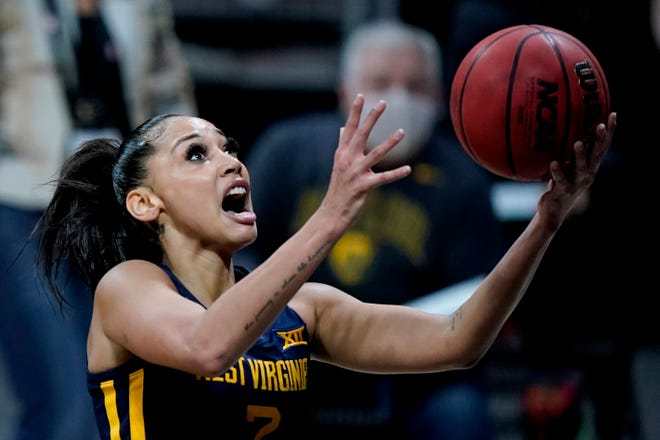 West Virginia's Kysre Gondrezick puts up a shot during the first half of an NCAA college basketball game against Baylor in the final round of the Big 12 Conference tournament in Kansas City, Mo, Sunday, March 14, 2021. (AP Photo/Charlie Riedel)