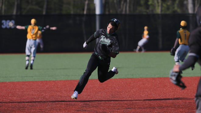 Trinity's Daylen Lile (10) approaches third base before heading home against St. X to score their first run during their game on Trinity's field in Louisville, Ky. on Apr. 14, 2021.  Trinity won 9-3.