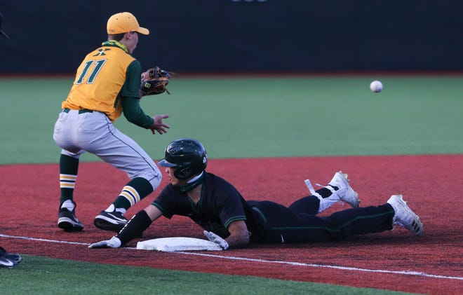Trinity's Daylen Lile (10) beat the throw to St. X's Landon Akers (11) at third base during their game on Trinity's field in Louisville, Ky. on Apr. 14, 2021.  Trinity won 9-3.