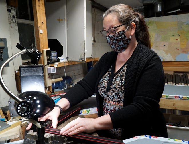 After her left eye was stuck with no better than 20/40 vision from an October 2020 accident where a 40-pound sandbag crashed through her car's windshield, Plymouth Frame Works owner Cindy Eckley still has to use her fingers to check alignment as she puts together frames. Her vision is not accurate enough.