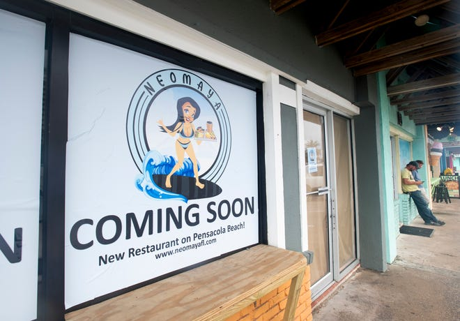 A new restaurant called Neomaya is advertised as coming soon at the former Dog House location on Via de Luna Drive in Pensacola Beach.