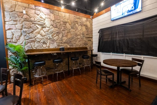 A rock wall and wine bar from Sue's were kept and relocated inside TAP Cafe. The owners hope to have the cafe open later this month.