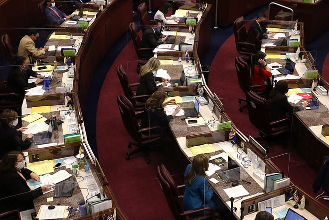 Lawmakers and staff are seen working in the Nevada State Legislative Building in Carson City on April 15, 2021.